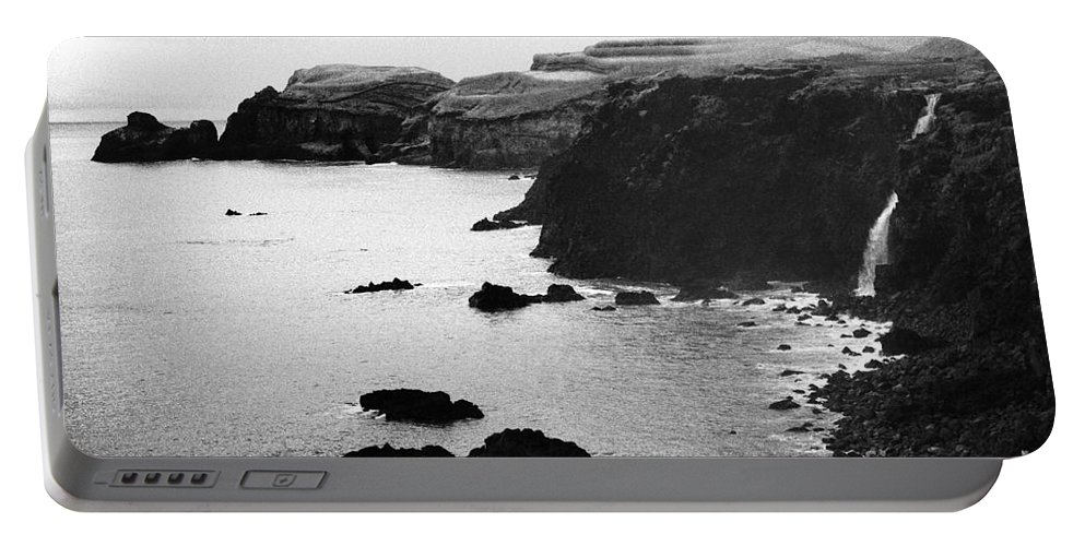 Savage Portable Battery Charger featuring the photograph Almost Pristine by Gaspar Avila