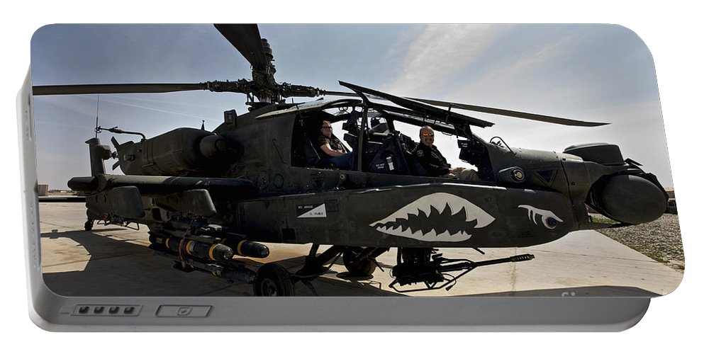 Ah-64 Portable Battery Charger featuring the photograph An Ah-64d Apache Helicopter Parked by Terry Moore