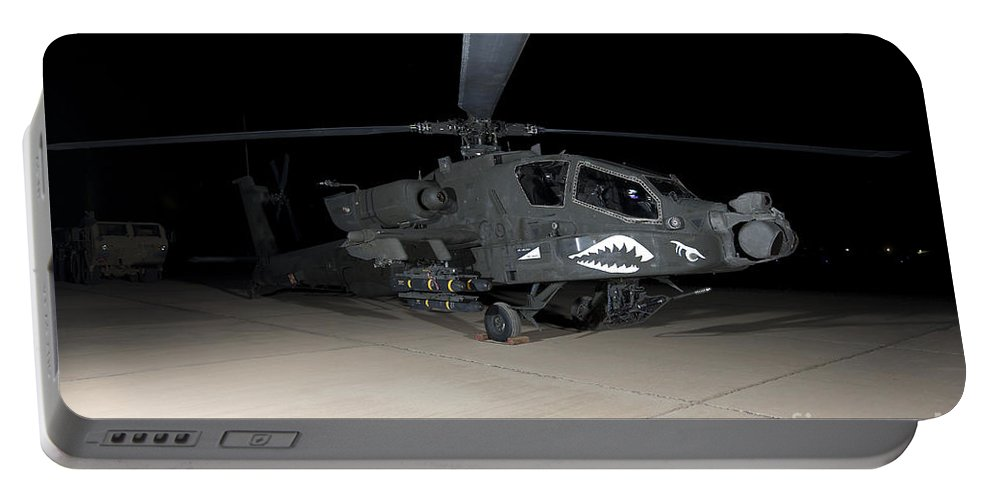 Ah-64 Portable Battery Charger featuring the photograph An Ah-64d Apache Longbow At Night by Terry Moore
