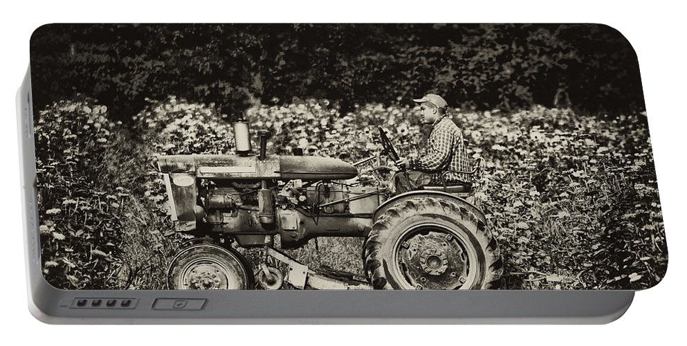 Farm Portable Battery Charger featuring the photograph An American Farmer by Bill Cannon