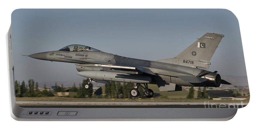 Turkey Portable Battery Charger featuring the photograph An F-16c Of The Pakistan Air Force by Giovanni Colla
