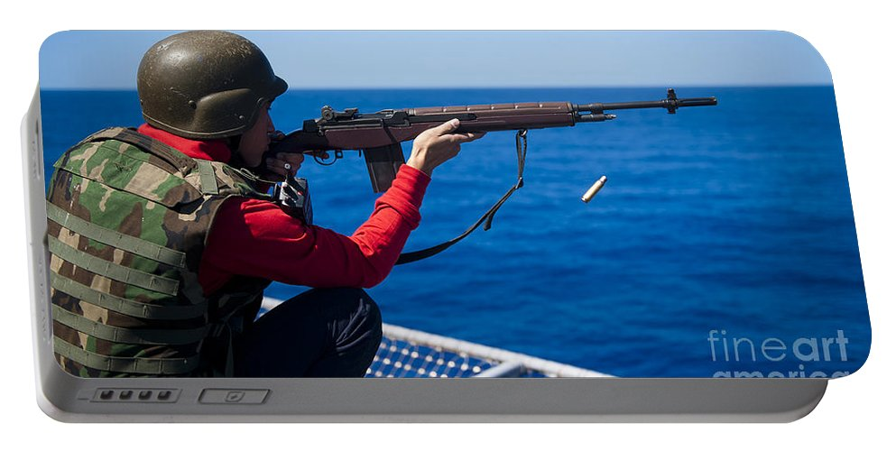 Shooting Portable Battery Charger featuring the photograph Aviation Ordnanceman Fires An M-14 by Stocktrek Images