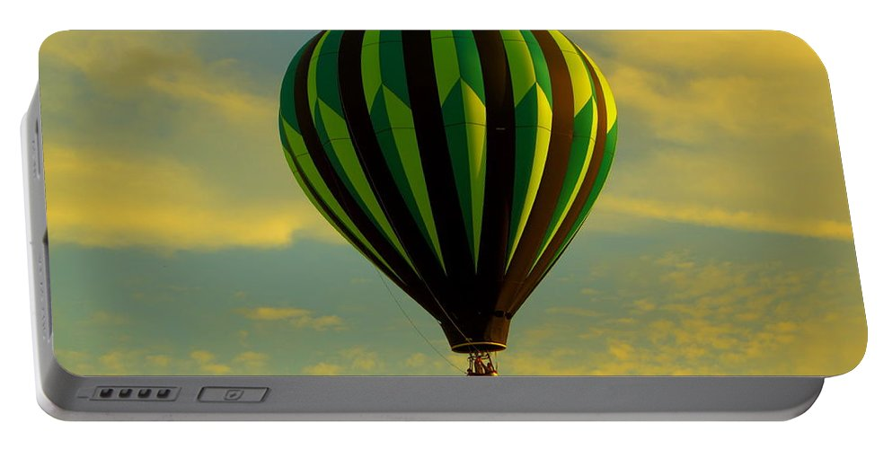 Balloon Race Portable Battery Charger featuring the photograph Balloon Ride Through Gold Clouds by Robert Frederick