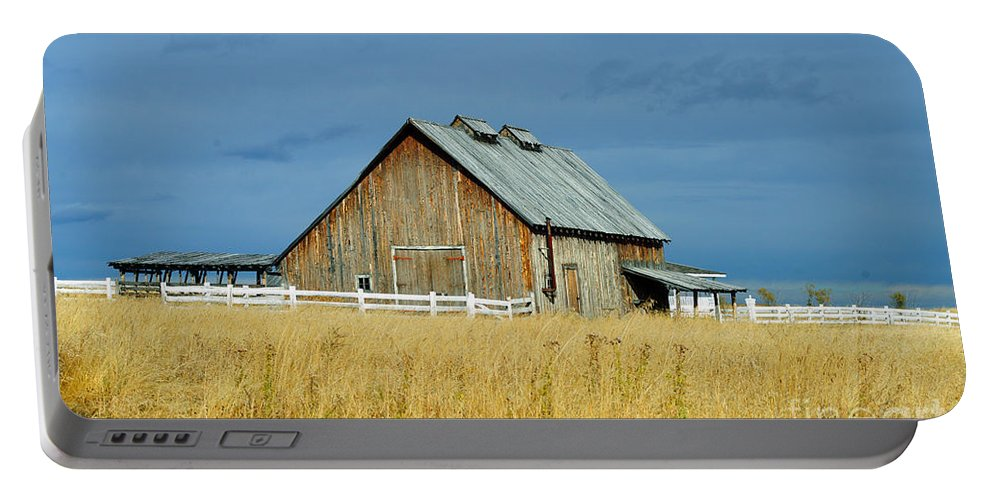 Old Barn Portable Battery Charger featuring the photograph Barn With Stormy Skies by Randy Harris