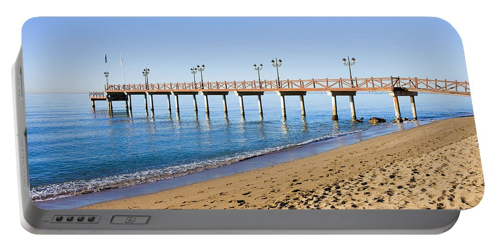 Beach Portable Battery Charger featuring the photograph Beach Pier In Marbella by Artur Bogacki