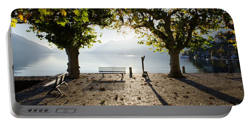 Bench Portable Battery Charger featuring the photograph Bench And Trees On The Lake Front by Mats Silvan