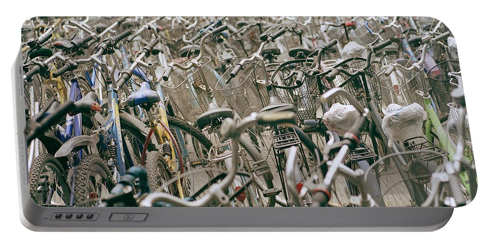 Cultural Portable Battery Charger featuring the photograph Bicycle Park In Beijing In China by Shaun Higson