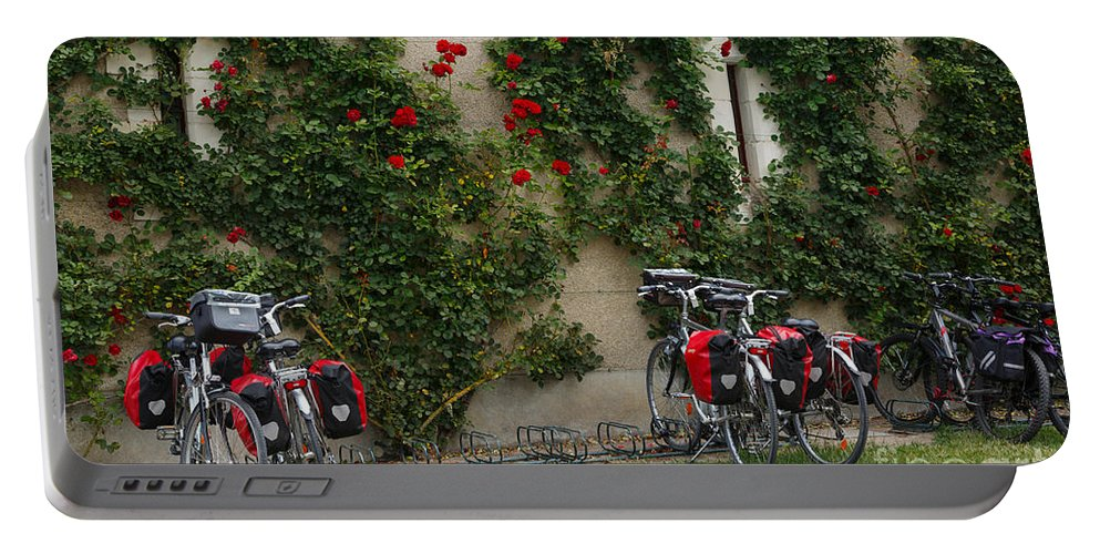 Bicycles Portable Battery Charger featuring the photograph Bicycles Parked By The Wall by Louise Heusinkveld