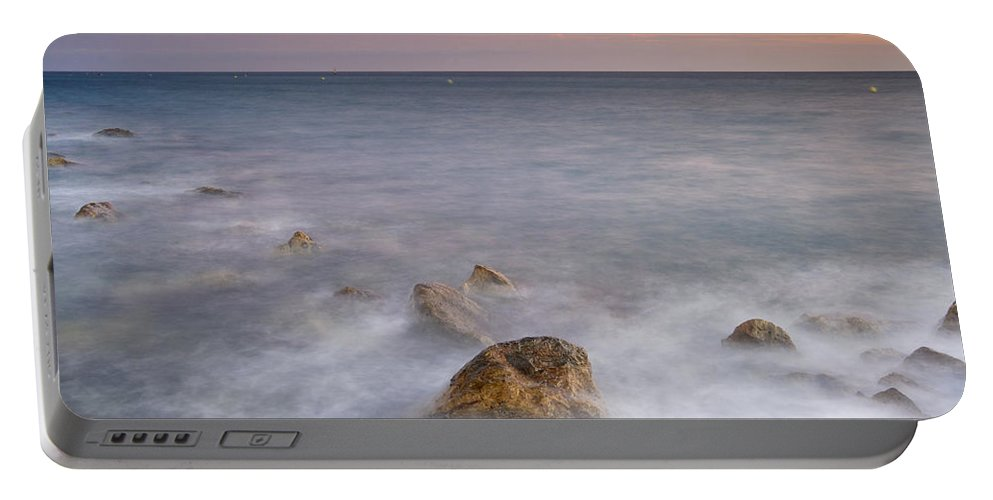 Pink Portable Battery Charger featuring the photograph Big Rock Against The Waves by Guido Montanes Castillo