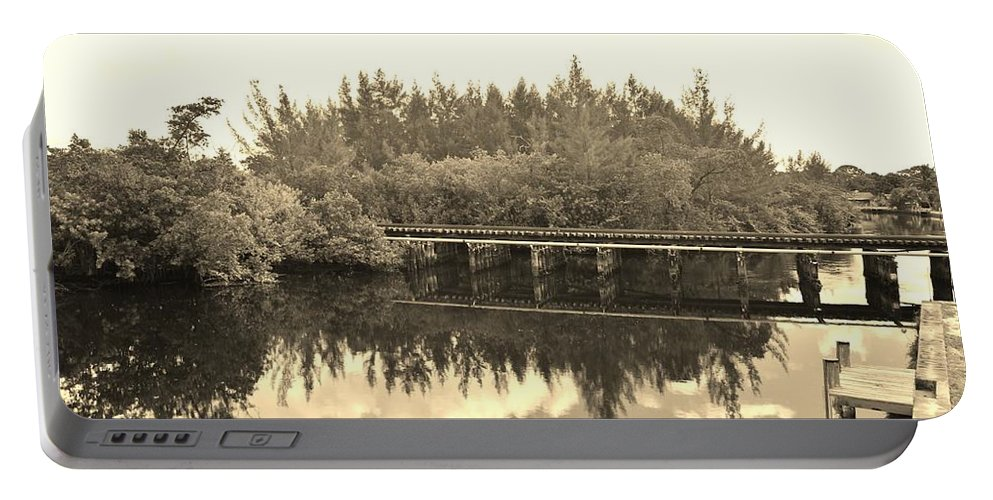 Black And White Portable Battery Charger featuring the photograph Big Sky And Dock On The River In Sepia by Rob Hans
