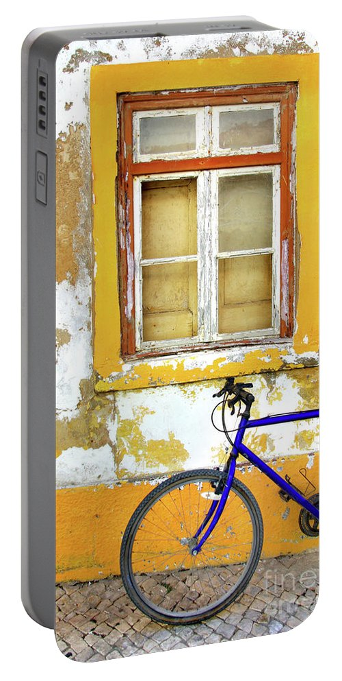 Aged Portable Battery Charger featuring the photograph Bike Window by Carlos Caetano