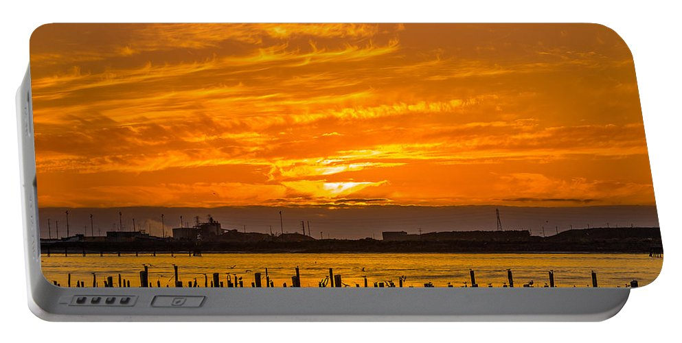 Sunset Portable Battery Charger featuring the photograph Blazing Humboldt Bay Sunset by Greg Nyquist
