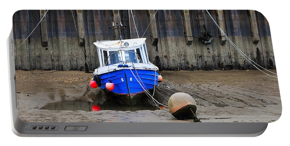 Anchored Portable Battery Charger featuring the photograph Blue Small Boat by Svetlana Sewell