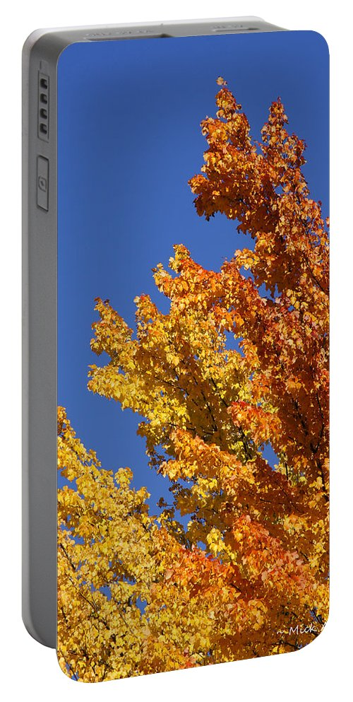 Blue Portable Battery Charger featuring the photograph Brilliant Fall Color And Deep Blue Sky by Mick Anderson