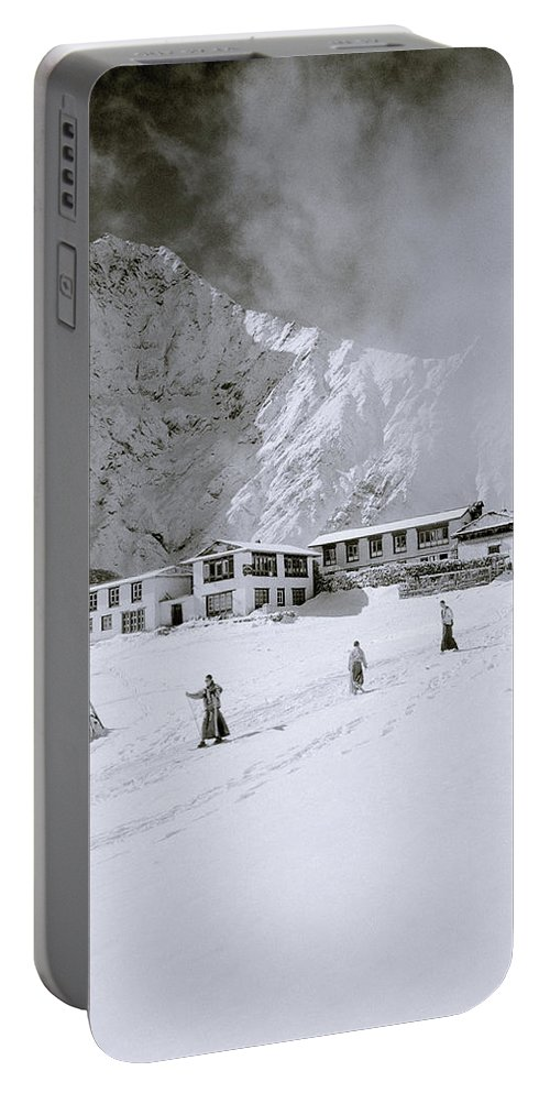 Himalaya Portable Battery Charger featuring the photograph Buddhism In The Himalaya by Shaun Higson