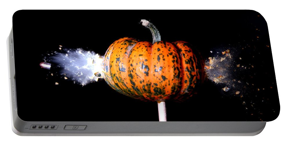Bullet Portable Battery Charger featuring the photograph Bullet Hitting A Squash by Ted Kinsman