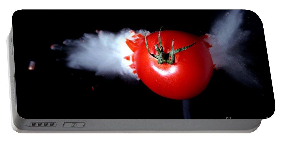 Bullet Portable Battery Charger featuring the photograph Bullet Hitting A Tomato by Ted Kinsman