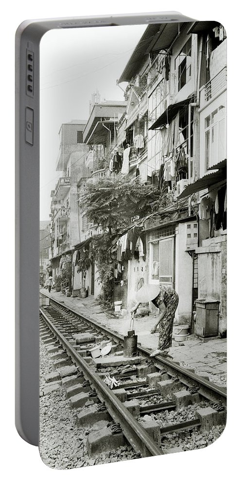 Asia Portable Battery Charger featuring the photograph By The Tracks In Hanoi by Shaun Higson