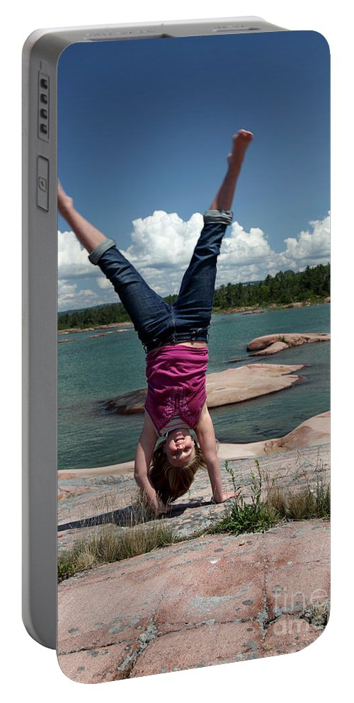 Girl Portable Battery Charger featuring the photograph Cartwheel by Ted Kinsman