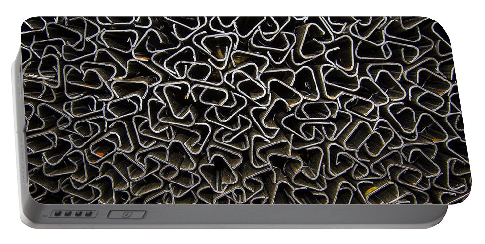 Design Portable Battery Charger featuring the photograph Chaos Of Stacked Metal Fencing by Jean Noren