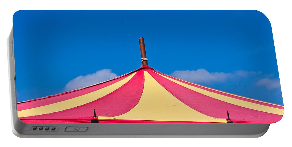 Blue Portable Battery Charger featuring the photograph Circus Tent Top by Tom Gowanlock