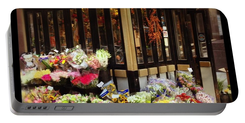 Portable Battery Charger featuring the photograph City Flowers by Mark Valentine
