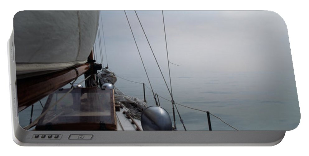 Sail Portable Battery Charger featuring the photograph Classic Wooden Sailboat With No Horizon Off The Bow by John Harmon