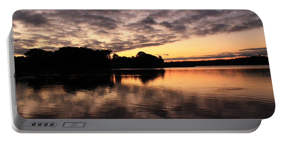 The Sun Before It Came Up Over Lake Norman Portable Battery Charger featuring the photograph Clouds Going Away At Sunrise by Catie Canetti