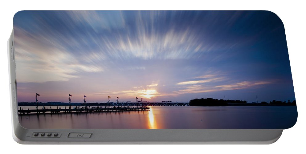 Sunset Portable Battery Charger featuring the photograph Clouds In Motion by Edward Kreis