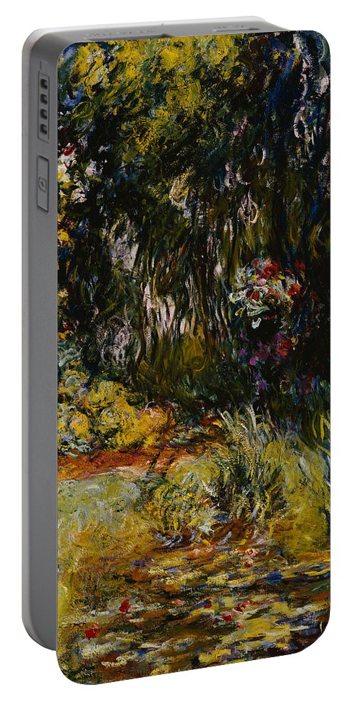 French Portable Battery Charger featuring the painting Corner Of A Pond With Waterlilies by Claude Monet