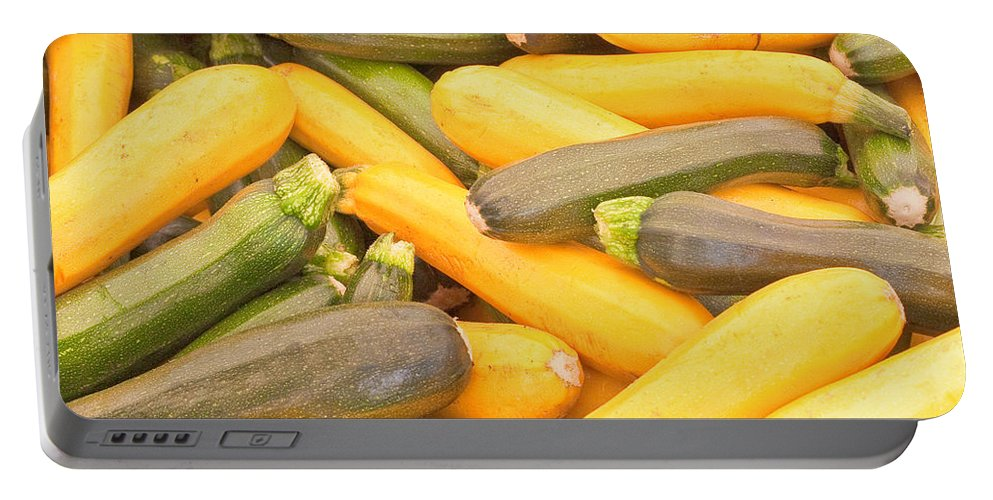 Abundance Portable Battery Charger featuring the photograph Courgettes by Tom Gowanlock