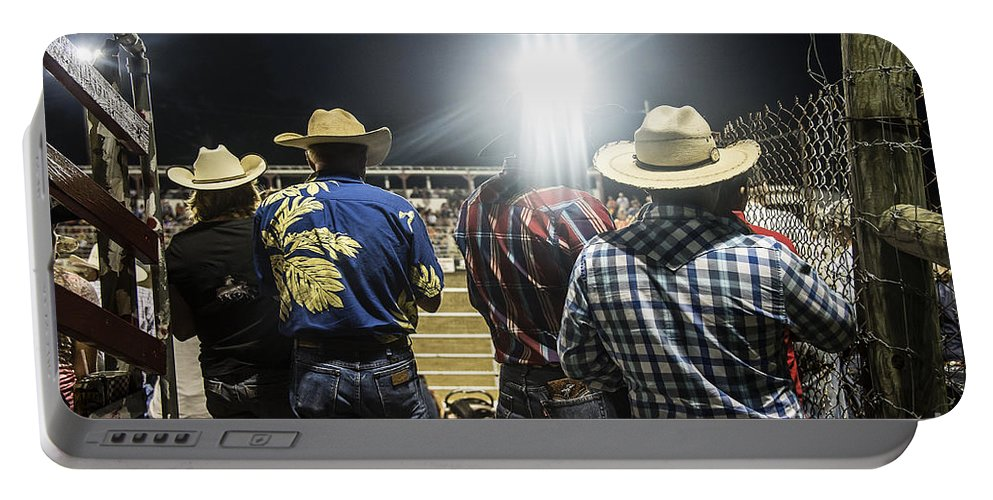 America Portable Battery Charger featuring the photograph Cowboys At Rodeo by John Greim