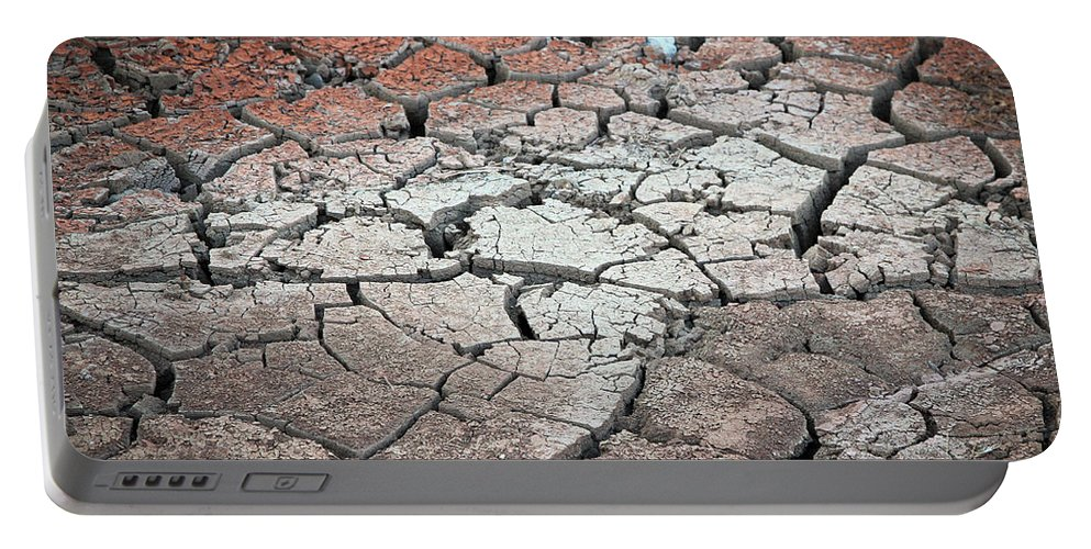 Desert Portable Battery Charger featuring the photograph Cracked Earth by Athena Mckinzie