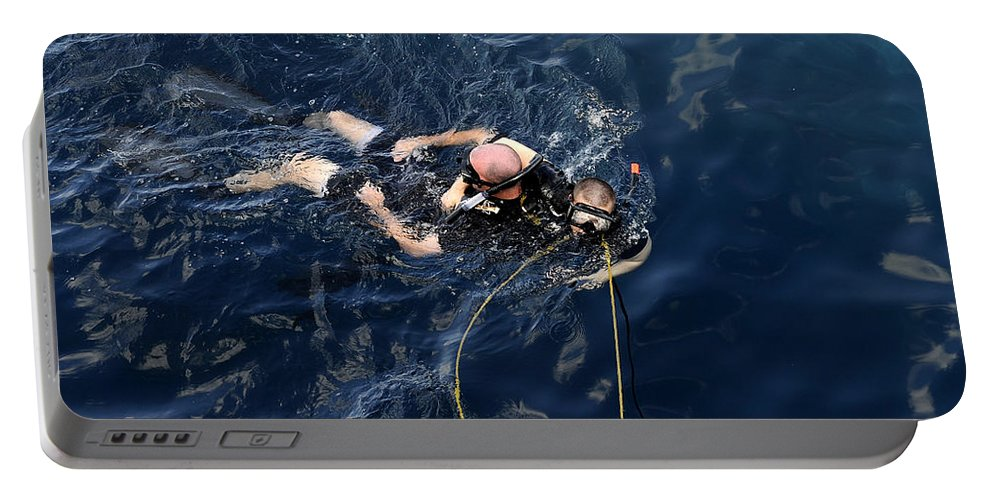 Diving Mask Portable Battery Charger featuring the photograph Damage Controlman Performs Training by Stocktrek Images