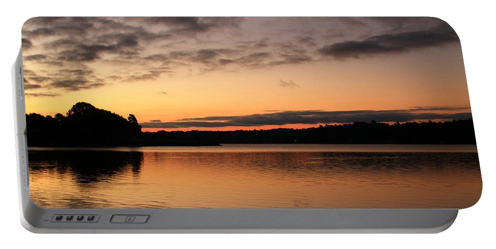 Sunrise Portable Battery Charger featuring the photograph Diminishing Clouds And Rising Sun by Catie Canetti