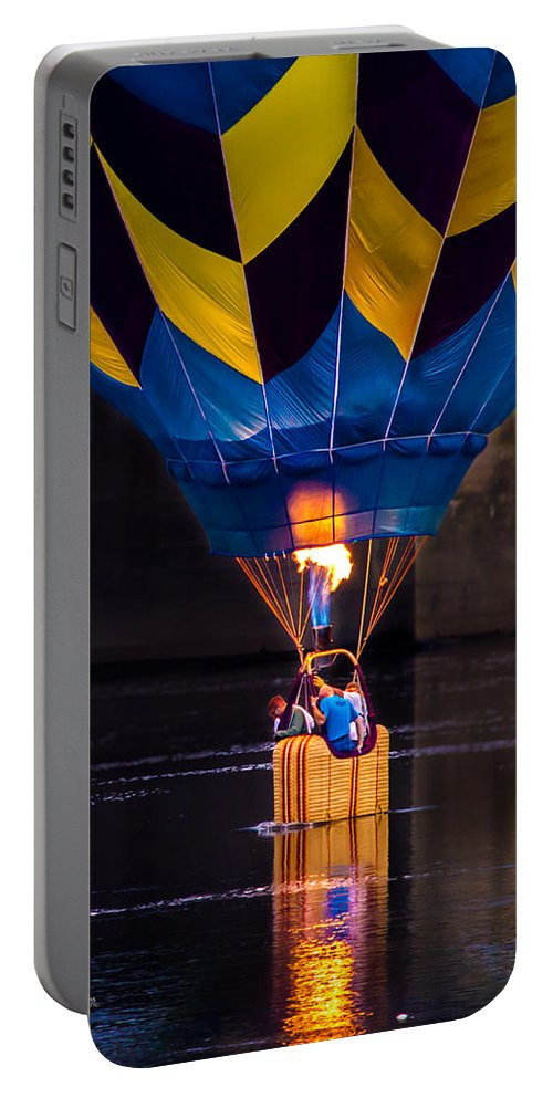 Water Scraping Portable Battery Charger featuring the photograph Dipping The Balloon Basket by Bob Orsillo