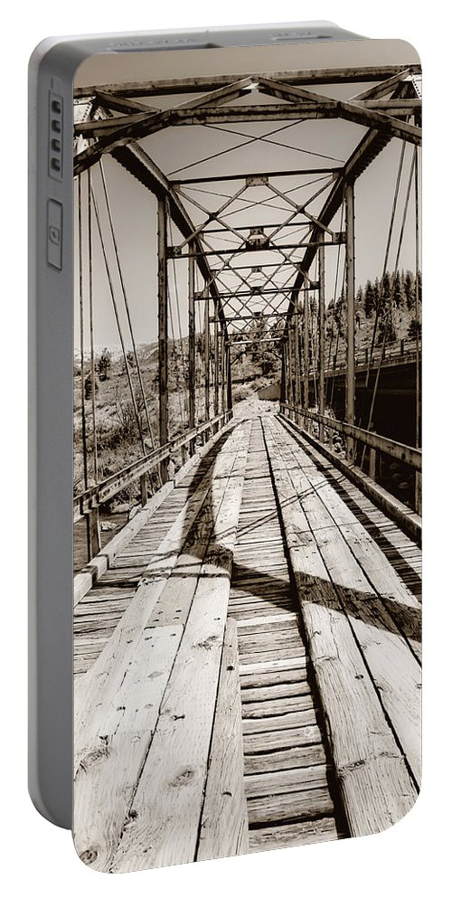 Bridge Portable Battery Charger featuring the photograph Discarded Bridges by Donna Blackhall