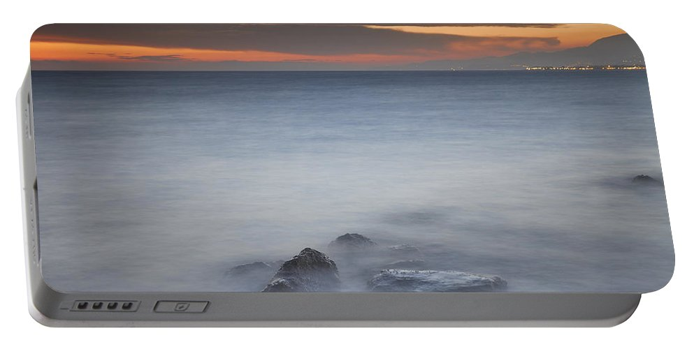 Seascape Portable Battery Charger featuring the photograph Dreaming by Guido Montanes Castillo
