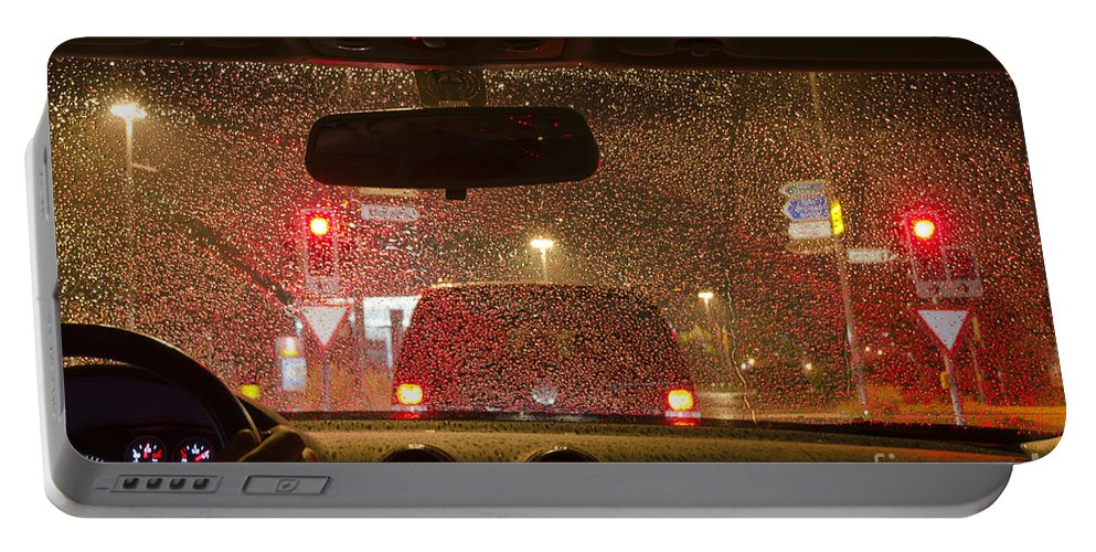 Car Portable Battery Charger featuring the photograph Driving A Car At Night by Mats Silvan