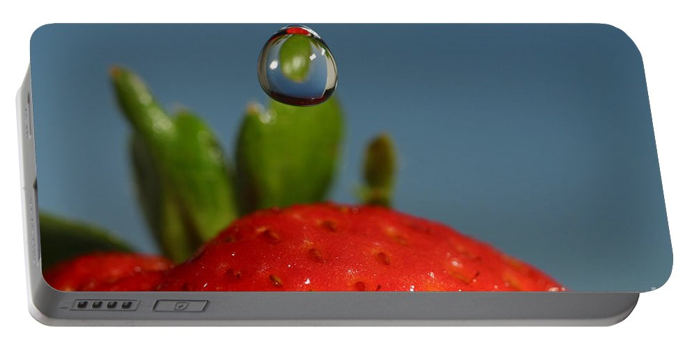 Strawberry Portable Battery Charger featuring the photograph Droplet Falling On A Strawberry by Ted Kinsman
