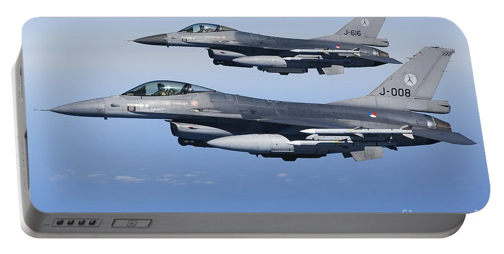 Aim-120 Portable Battery Charger featuring the photograph Dutch F-16ams During A Combat Air by Gert Kromhout
