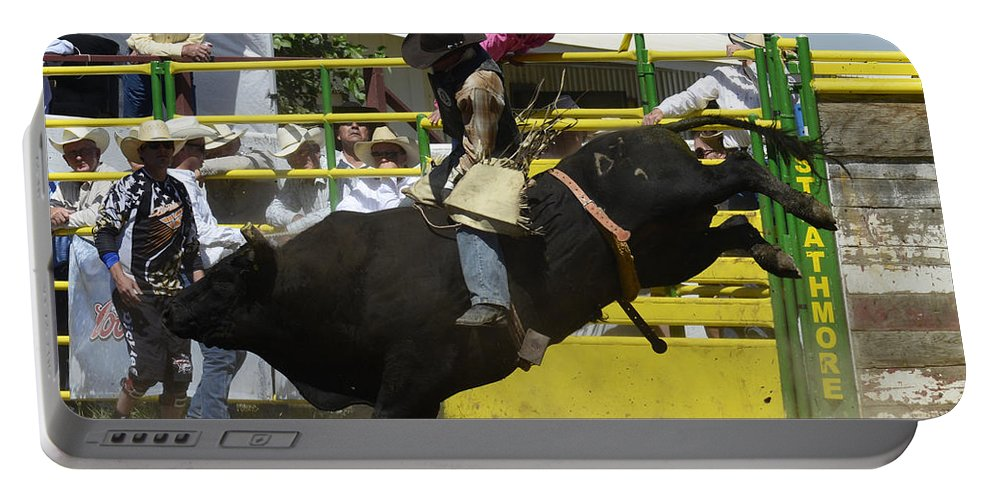 Rodeo Bull Riding Portable Battery Charger featuring the photograph Rodeo Eight Seconds by Bob Christopher