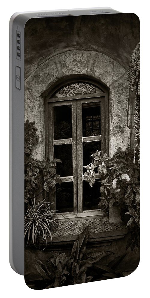 El Sitio Portable Battery Charger featuring the photograph El Sitio Window by Tom Bell