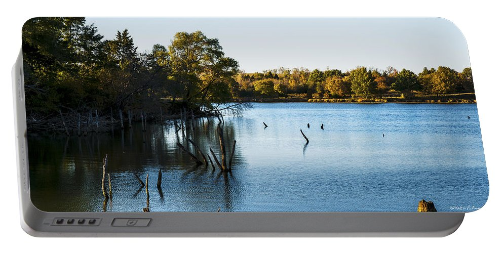 Sunset Portable Battery Charger featuring the photograph Fall Sunset At Standing Bear Lake by Edward Peterson