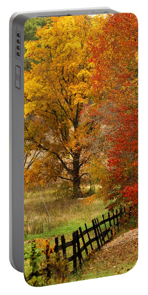 Black Fence Portable Battery Charger featuring the photograph Fence In Autumn by Randall Branham