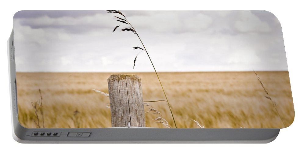 Agriculture Portable Battery Charger featuring the photograph Fence Post by Tom Gowanlock