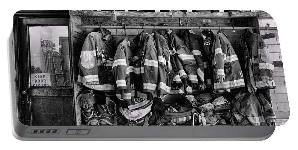 Fireman Portable Battery Charger featuring the photograph Fireman - Jackets Helmets And Boots by Paul Ward