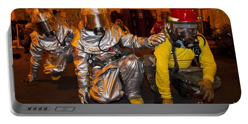 Crouching Portable Battery Charger featuring the photograph Firemen Brace For Shock by Stocktrek Images