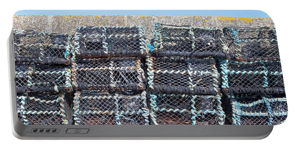 crab Nets Portable Battery Charger featuring the photograph Fishing Baskets by Tom Gowanlock
