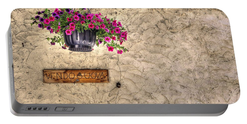 Flowers Portable Battery Charger featuring the photograph Flowers And A Signboard by Mats Silvan